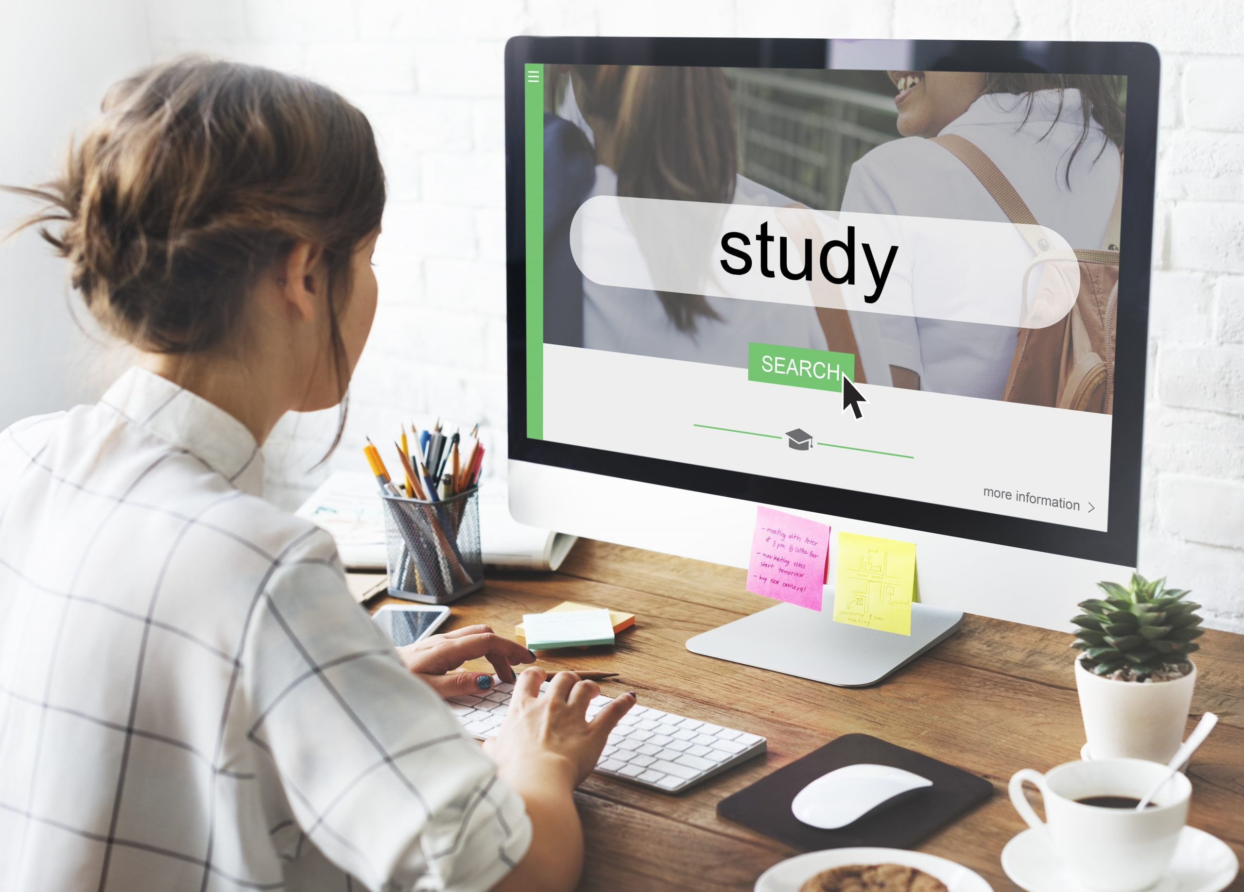 "Woman at a computer with the word ""study"" on the screen"